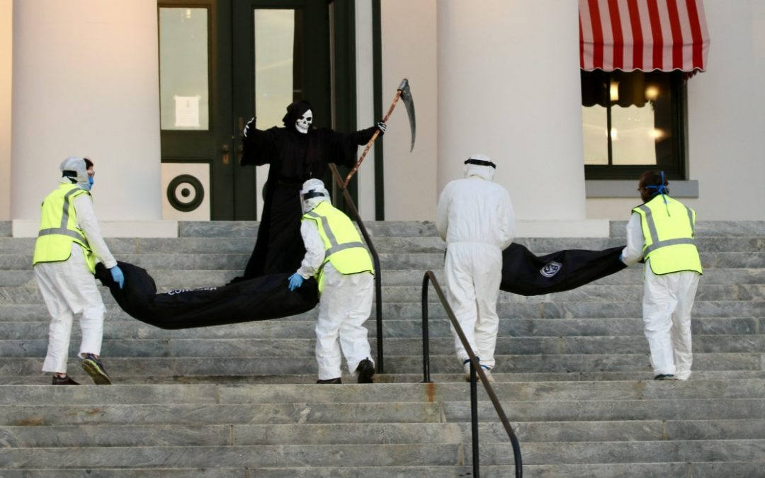 Advocates line body bags outside Florida capitol to  protest state's reopening